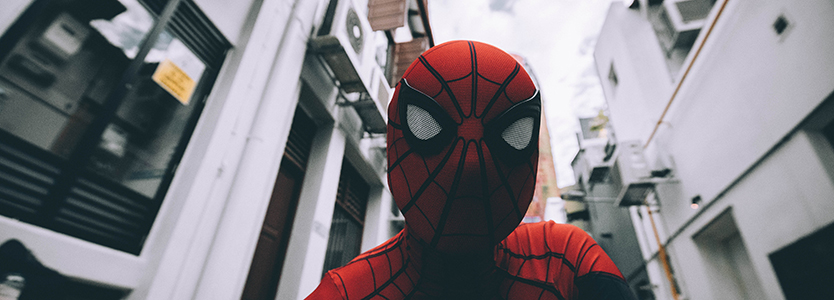 A man in a Spider-Man outfit in the street
