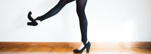 A pair of legs in high heels and Spandex leggings