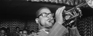 Dizzy Gillespie playing the trumpet in a jazz club