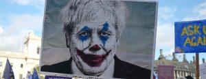 A protest sign of Boris Johnson as the Joker from Batman